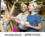 smiling customers buying bread... | Shutterstock . vector #389874202