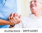 Stock photo nurse holding hand of senior man in rest home 389916085