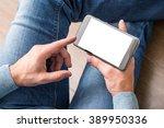 Smartphone In Man's Hands. Vie...