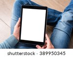 man using tablet computer while ... | Shutterstock . vector #389950345
