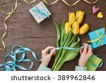 female hands with tulips
