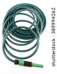 garden hose coiled on plain... | Shutterstock . vector #389994262