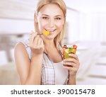portrait of happy woman eating... | Shutterstock . vector #390015478