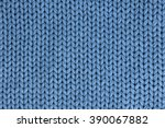 the texture of a knitted woolen ... | Shutterstock . vector #390067882