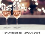 Stock photo wine glasses in a restaurant setting 390091495