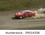 red rally car in a race