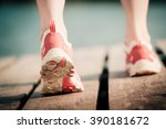 feet of jogging woman. summer... | Shutterstock . vector #390181672