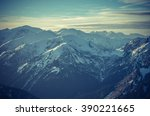 mountain panorama at winter in... | Shutterstock . vector #390221665