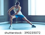 stretching after great work out.... | Shutterstock . vector #390235072