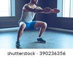 deep squat. part of young man... | Shutterstock . vector #390236356