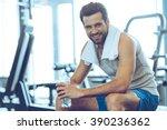 little break. handsome young... | Shutterstock . vector #390236362