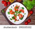 caprese salad. italian cuisine. ... | Shutterstock . vector #390335332