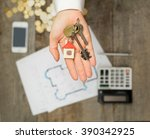 real estate agent handing over... | Shutterstock . vector #390342925