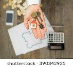 real estate agent handing over... | Shutterstock . vector #390342925