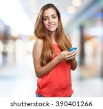 young cute woman using her... | Shutterstock . vector #390401266