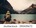 a female hiker at lake louise... | Shutterstock . vector #390439672