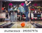 concentrated man throwing ball... | Shutterstock . vector #390507976