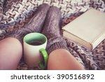 woman legs in woolen socks with ... | Shutterstock . vector #390516892