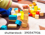 small child playing with wooden ... | Shutterstock . vector #390547936