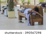 Homeless People Sleeps On Benc...