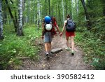 young couple hikers in forest.... | Shutterstock . vector #390582412