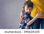 sad little child  boy  hugging... | Shutterstock . vector #390634105