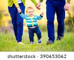 parents holding hands of their... | Shutterstock . vector #390653062