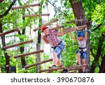 Small photo of adventure climbing high wire park - people on course in mountain helmet and safety equipment