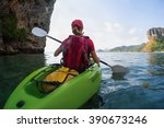 sporty lady paddle the kayak in ... | Shutterstock . vector #390673246