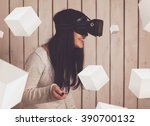 woman in virtual reality helmet.... | Shutterstock . vector #390700132