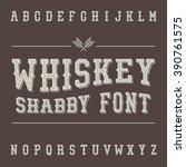 shabby vintage whiskey font.... | Shutterstock .eps vector #390761575