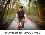 senior man on his mountain bike ... | Shutterstock . vector #390767452