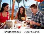three friends enjoying meal... | Shutterstock . vector #390768346