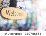 wood welcome sign hanging.... | Shutterstock . vector #390786556