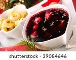 red borscht with mushroom ravioli as traditional christmas eve soup - stock photo