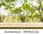 image of wood table top on blur ... | Shutterstock . vector #390961216