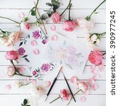 Stock photo workspace pink and red roses painted with watercolor paintbrush and roses on white wooden 390977245
