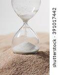 glass hourglass standing in... | Shutterstock . vector #391017442