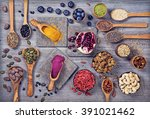 super foods in spoons and bowls ... | Shutterstock . vector #391021462