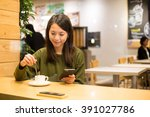 woman enjoy her coffee and... | Shutterstock . vector #391027786