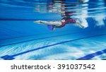Female Swimmer Swimming Pool...
