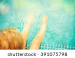 baby sitting near swimming pool. | Shutterstock . vector #391075798