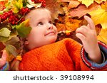 Girl in autumn orange leaf and red berry. Outdoor. - stock photo