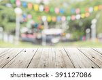 empty wooden table with blurred ... | Shutterstock . vector #391127086