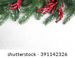 snowy fir twigs and red berries ... | Shutterstock . vector #391142326