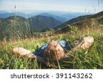 Man Lying In High Green Grass...