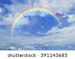 rainbow with white clouds over... | Shutterstock . vector #391143685