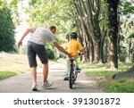 father learn his little son to... | Shutterstock . vector #391301872