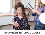 female hairdresser applying... | Shutterstock . vector #391326466