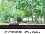 White Cup Of Hot Coffee On...